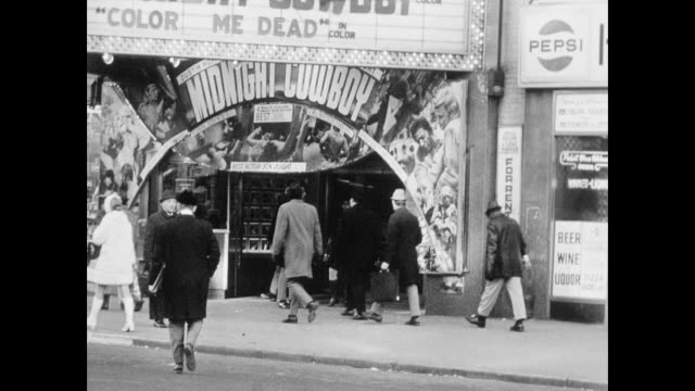 people walking past theater advertising midnight cowboy pan along street storefronts amusement center theater playing the honeymoon killers - theater marquee commercial sign stock videos & royalty-free footage