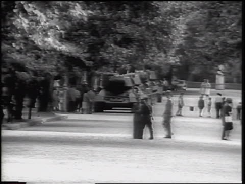 b/w 1961 people walking tanks on city street / berlin / after construction of berlin wall - 1961 stock-videos und b-roll-filmmaterial