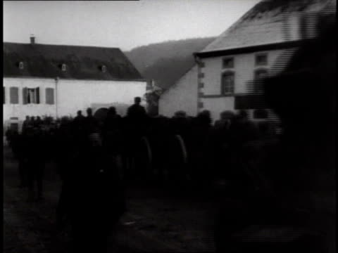 vidéos et rushes de people walking the streets as trucks carrying soldiers pass by / germany - 1918