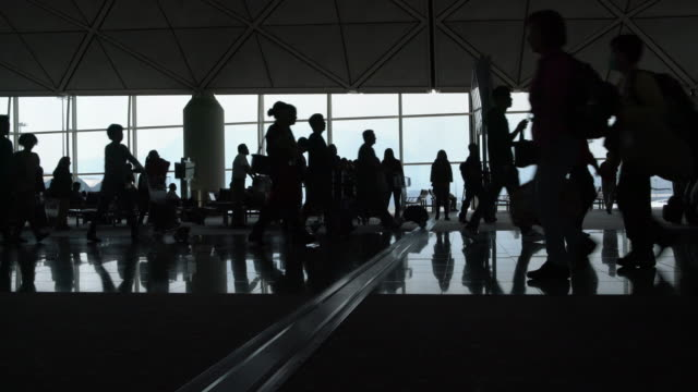WS People walking through a busy airport, Hong Kong