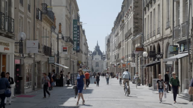 people walking through a town centre / rennes, france - rennes frankreich stock-videos und b-roll-filmmaterial