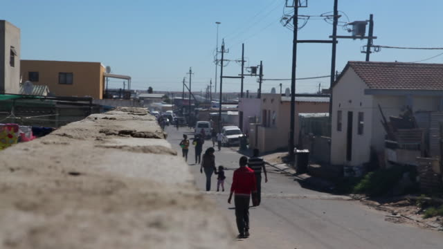 people walking through a township in cape town - cape town stock videos & royalty-free footage