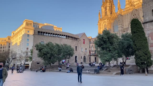 people walking through empty streets after covid 19 in barcelona, spain. sunset in spring 2021 downtown ramblas - walkable city stock videos & royalty-free footage