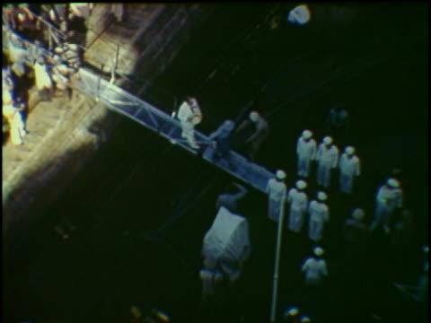 HA WS People walking through gangplank onto USS Missouri warship docked at Panama Canal Panama