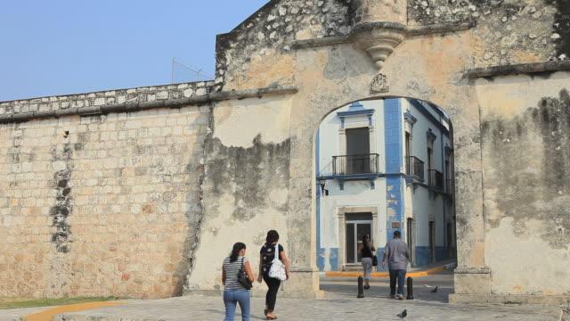 WS People walking through large gate, Merida, Yucatan, Mexico
