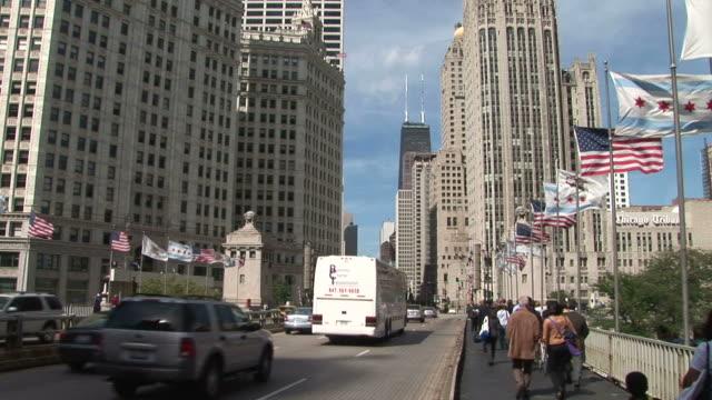 people walking through michigan avenue bridge in chicago united states - michigan avenue bridge stock videos and b-roll footage
