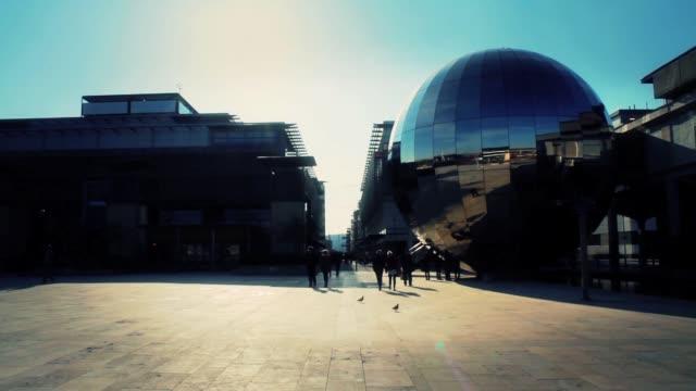 people walking through millennium square, bristol uk - bristol england stock videos and b-roll footage