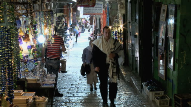 WS People walking through narrow Old Town street lined with shops / Jerusalem, Israel