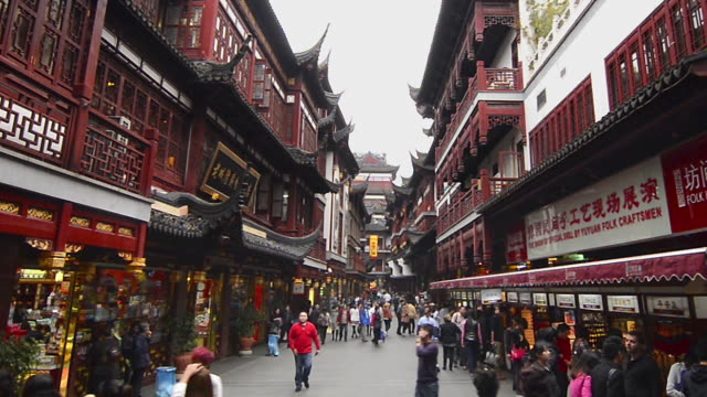 wa zo people walking through old town / shanghai, china - old town stock videos & royalty-free footage