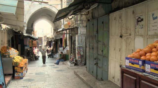 ws pan people walking through old town street / jerusalem, israel - jerusalem stock videos & royalty-free footage