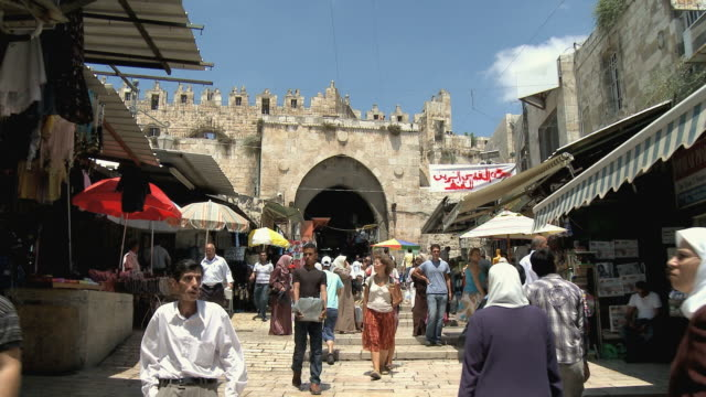 WS PAN People walking through stone gate in old city walls / Jerusalem, Israel