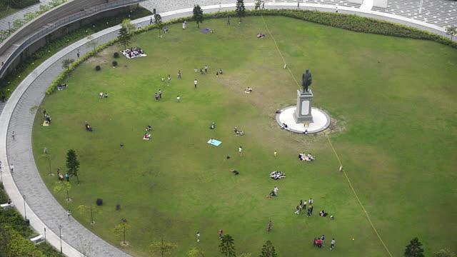 T?L WA HA People walking through Sun Yat Sen Park