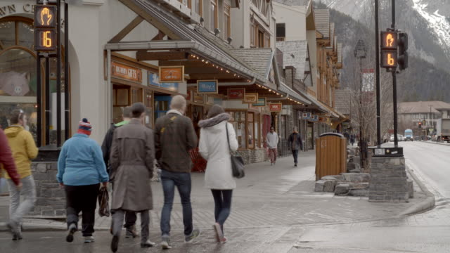 people walking through the town / banff, canada - banff stock videos & royalty-free footage