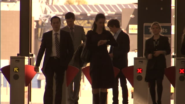 MS, People walking through ticket barriers at Olympic Park railway station, Sydney, Australia