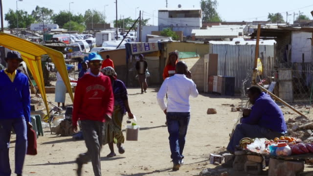 ws people walking through town / diepsloot, south africa - casual clothing stock videos & royalty-free footage