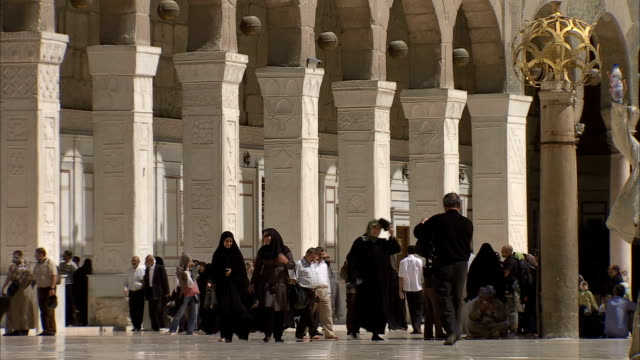 people walking through umayyad mosque (great mosque of damascus), damascus, syria - syria stock videos & royalty-free footage