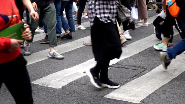 people walking through zebra crossing - zebra crossing stock videos & royalty-free footage
