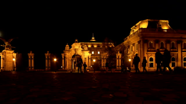 people walking to budapest royal palace at night - royal palace of buda stock videos & royalty-free footage