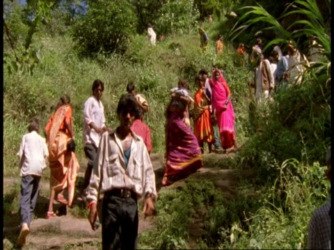 ms people walking to temple, bandhavgarh national park, india - national icon stock videos & royalty-free footage