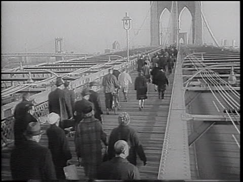 people walking to work across brooklyn bridge during transit strike / nyc / newsreel - 1966 stock videos & royalty-free footage