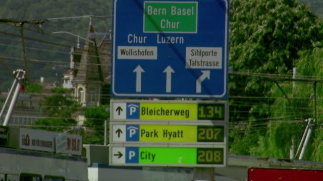 ms tu td people walking, trolley bus on street / zurich, switzerland  - trolley bus stock videos & royalty-free footage