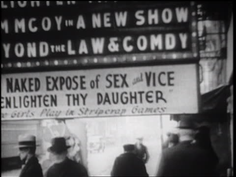 B/W 1934 people walking under sign Naked Expose of Sex and Vice Enlighten Thy Daughter