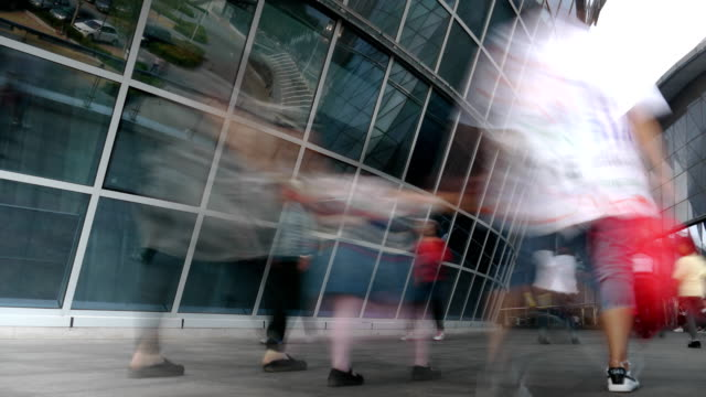 people walking under the building glass curtain wall - curtain wall facade stock videos and b-roll footage