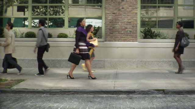 WS People walking up and down sidewalk, Tribeca, New York, USA