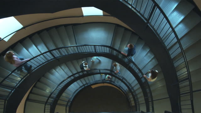 WS HA People walking up and down spiral stairs, Orem, Utah, USA