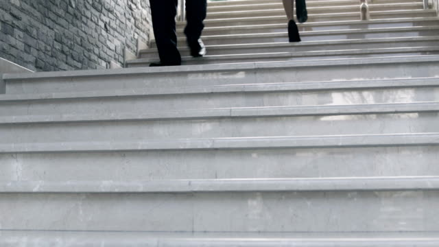 People walking up and down the staircase