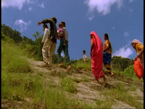 ms people walking up hillside, bandhavgarh national park, india - national icon stock videos & royalty-free footage