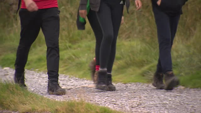 people walking up mount snowdon, wales - leisure activity stock videos & royalty-free footage