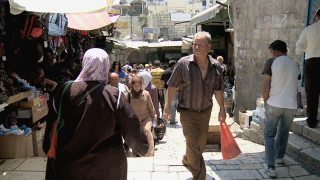 MS PAN People walking up steps in narrow stone paved street in old town / Jerusalem, Israel