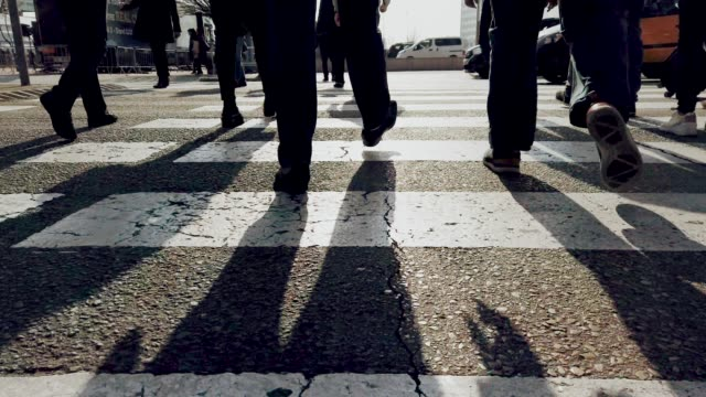 people walking - zebra crossing stock videos & royalty-free footage