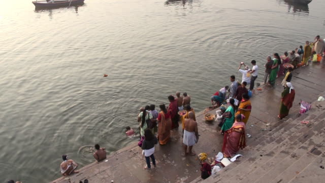 people washing in ganges river, varanasi, india - taking a bath stock videos and b-roll footage