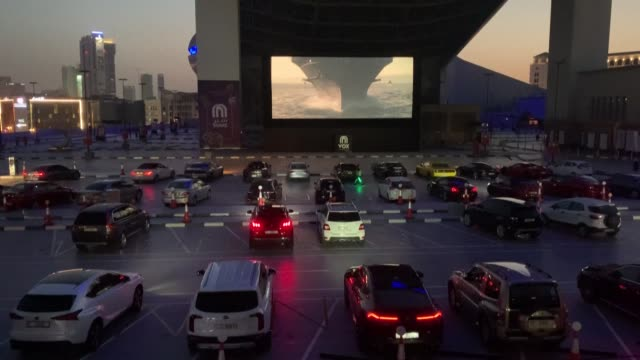ARE: People watch a movie in their cars at a drive-in cinema in Dubai