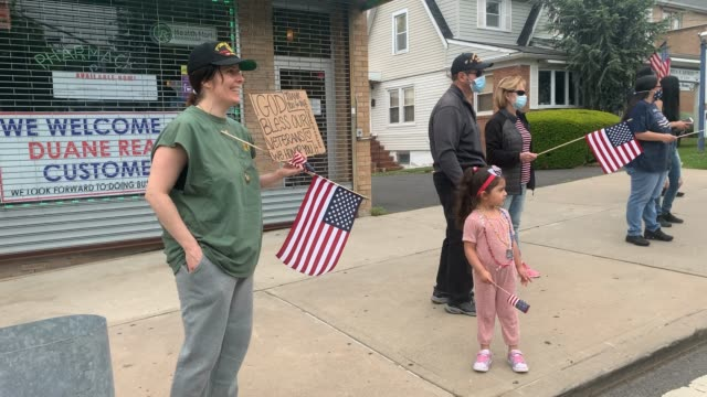 people watch and wave flags in the annual memorial day parade in the annual memorial day parade on may 25, 2020 in the staten island borough of new... - veterans day stock videos & royalty-free footage