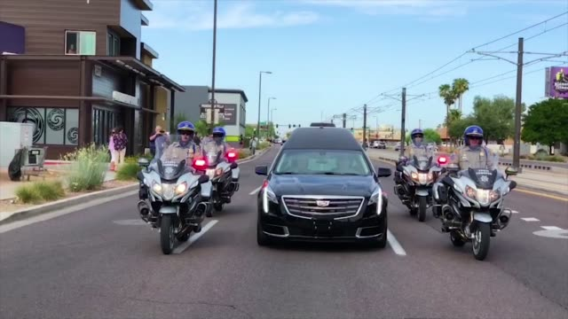 people watch as a hearse carrying the casket of us sen john mccain is escorted by arizona state troopers to a memorial service at the north phoenix... - memorial event stock videos and b-roll footage