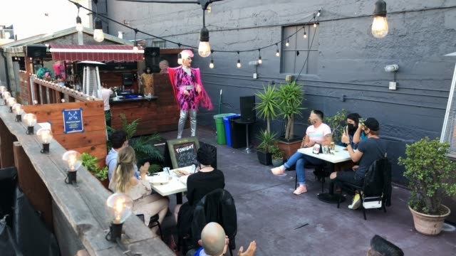 people watch as drag performer roxy brooks-lords performs during an in person outdoors drag show at sf on september 04, 2020 in san francisco,... - performance stock videos & royalty-free footage