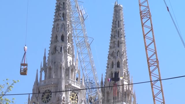 people watch as workers work on april 17, 2020 on the removal of the north tower of zagreb's iconic cathedral that is threatening to collapse after... - tower stock videos & royalty-free footage