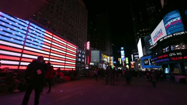 people watch election results on large digital screens in times square on november 03, 2020 in new york city. after a record-breaking early voting... - joe 03 stock videos & royalty-free footage