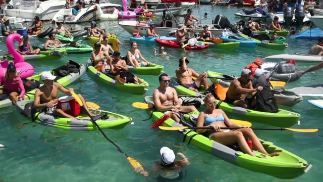 people watch france playing against croatia in the world cup final as it is being broadcast from the ballyhoo media boat setup in the intracoastal... - final round stock videos & royalty-free footage