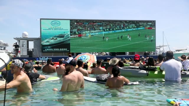 people watch france playing against croatia in the world cup final as it is being broadcast from the ballyhoo media boat setup in the intracoastal... - fifa world cup stock videos & royalty-free footage