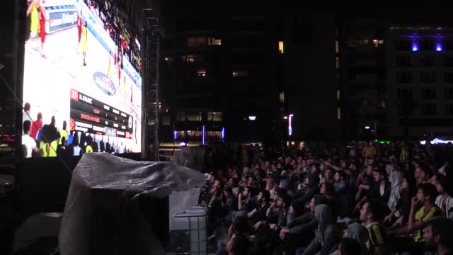 People watch the Turkish Airlines Euroleague Final Four Championship match between Fenerbahce and Olympiacos on a giant screen in Izmir Turkey on May...