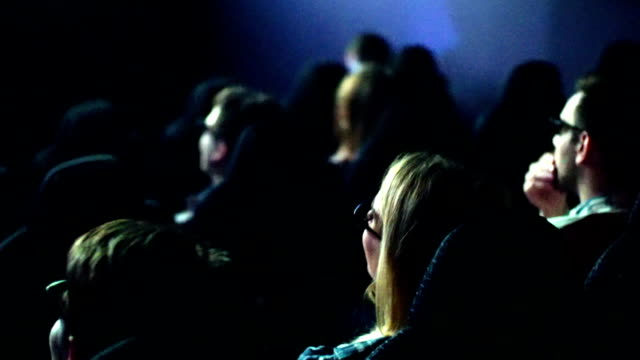 people watching a movie at movie theater. - movie stock videos & royalty-free footage
