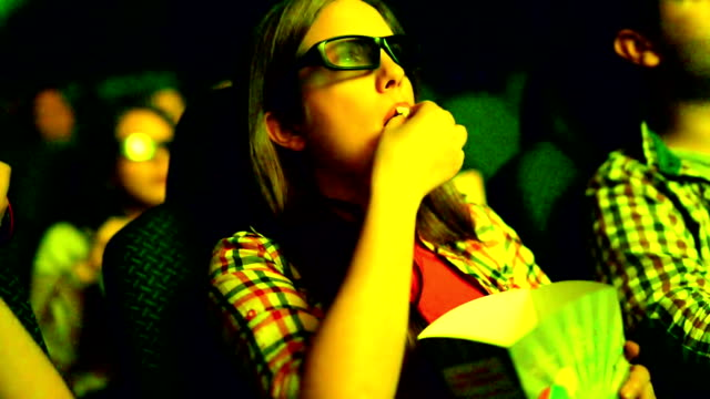 People watching a movie at movie theater.