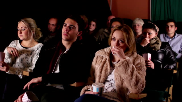 People watching a sad movie at the cinema / Theatre