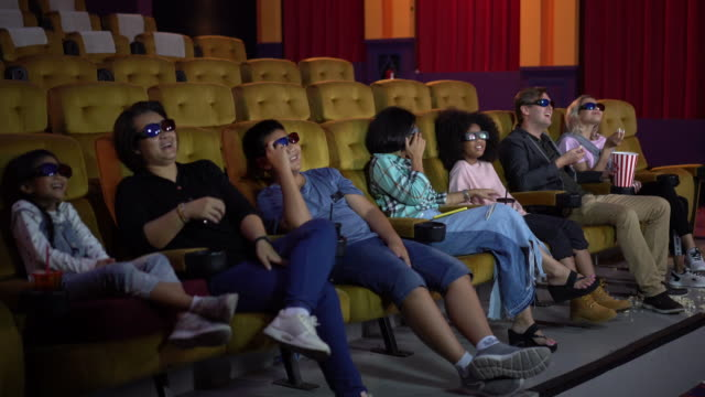 people watching movie and laughing 3d movies - 3d glasses stock videos & royalty-free footage