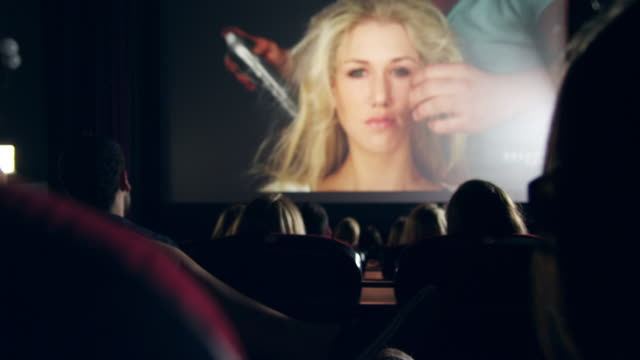 people watching movie - projection screen stock videos & royalty-free footage