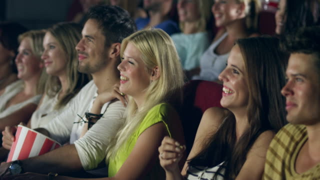 people watching movie - cinema stock videos & royalty-free footage